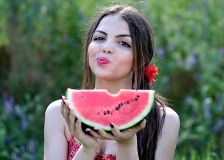 Girl with watermelon smiling