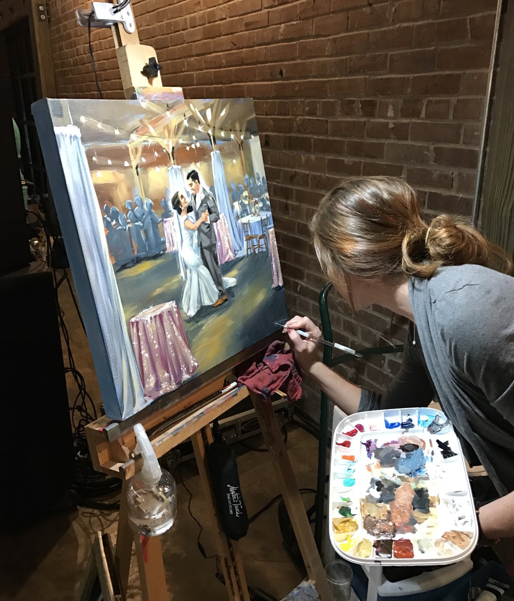 Stephanie Torregrossa signing a painting done at a 2017 wedding in Lake Charles, La.