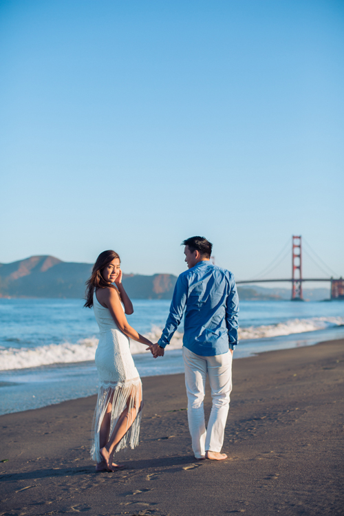 engagement-session-sanfrancisco-girl-looking-back-at-camera-bakers-beach-golden-gate-bridge