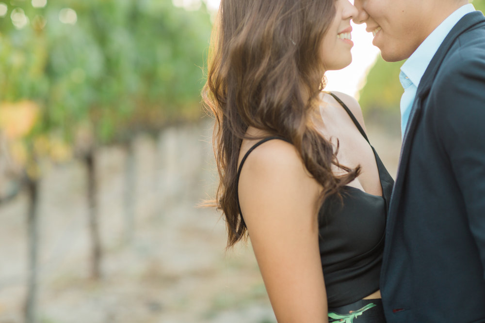 couple-nose-to-nose-smiling-in-napa-valley-winery-engagement-session