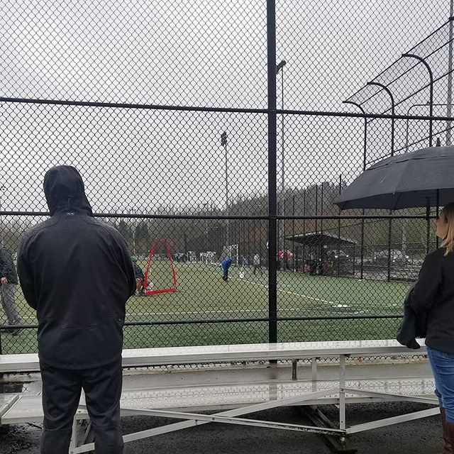 Baseball tryouts in the Pacific Northwest involves a lot of hoods and umbrellas. #rain #pacificnorthwest #northwet #baseball #littleleague #fatherhood #takemeouttotheballgame