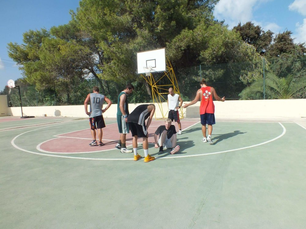 Outdoor 3-on-3 tournament in Malta. The six players on the court are from six different countries: Iceland, Greece, Latvia, Canada, the United States, and somewhere in Eastern Europe.