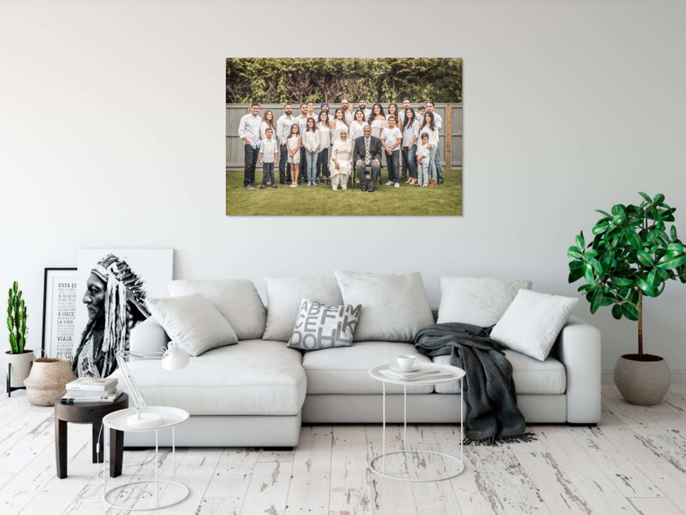 """An appropriately sized wall portrait of a family of 25 (40""""x60"""")."""