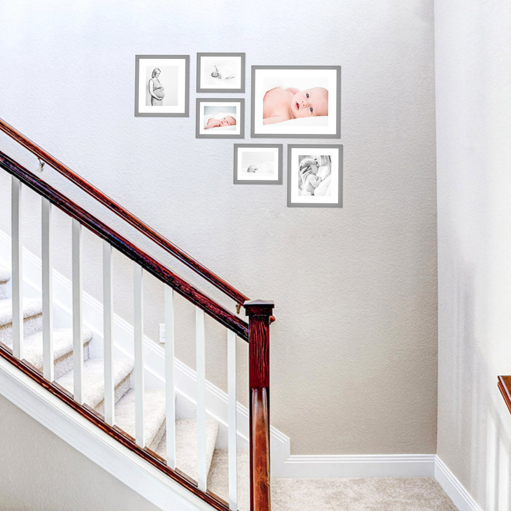 """Stairs or entryway - great spot for a photo collage. These don't need to be very large, since you will be walking up close to them often. Largest piece is a 16""""x20"""" framed fine art print."""