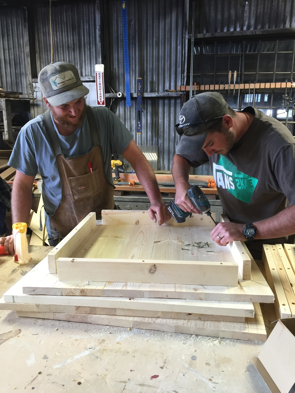 JEREMIAH AND JOSIAH SIMPSON WORKING ON A CUSTOM TABLE ORDER