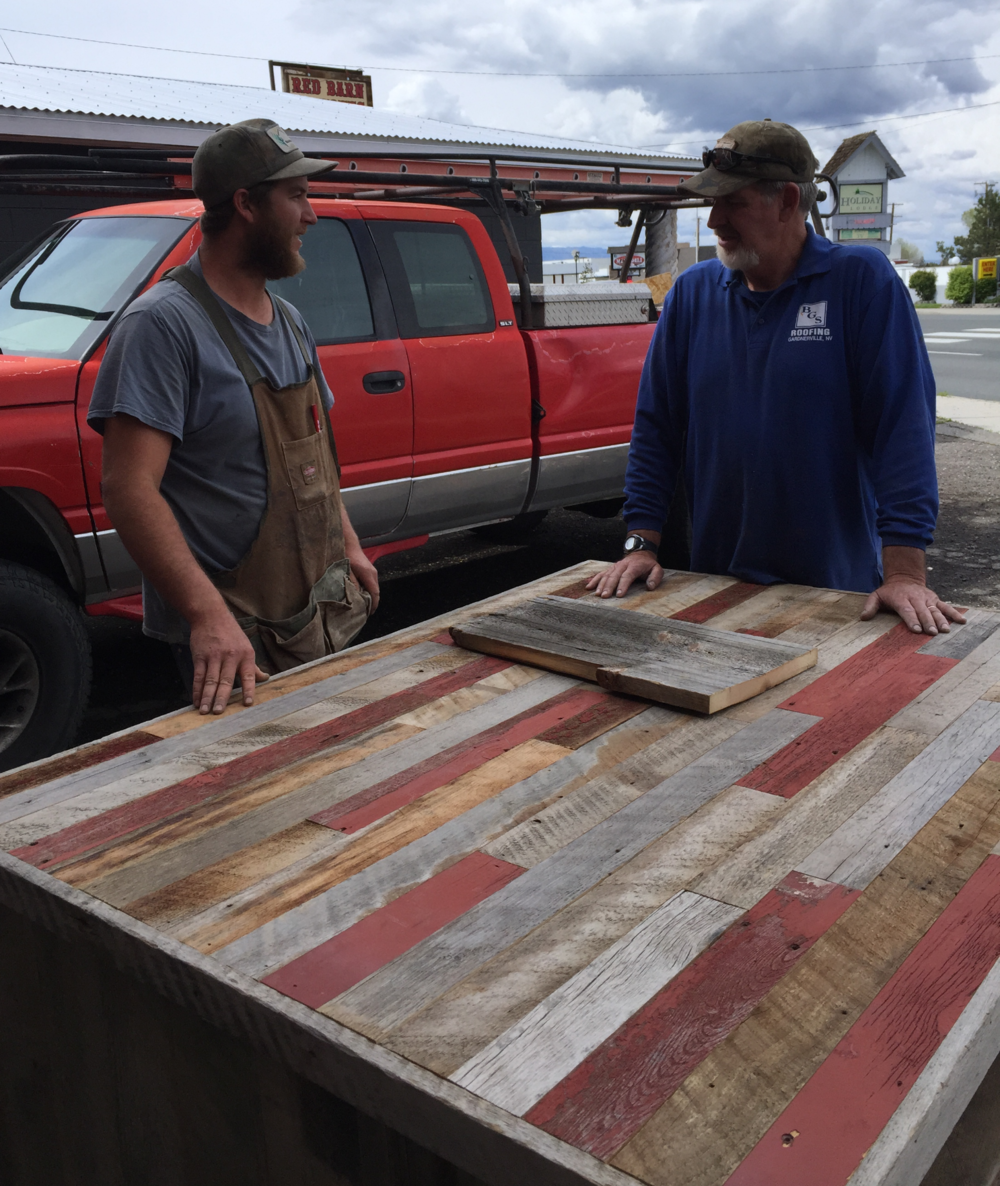 BARRY AND JEREMIAH SIMPSON ADMIRING A CUSTOM ORDER KITCHEN ISLAND READY TO BE DELIVERED.