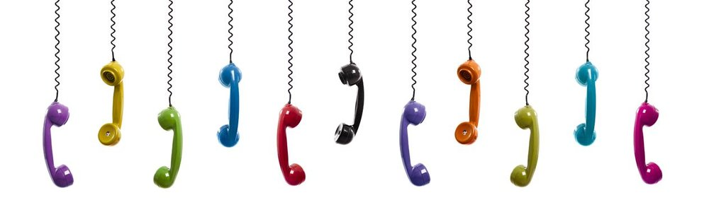 12165261 - multi colored handset pieces suspended by the phone cord, isolated on white background