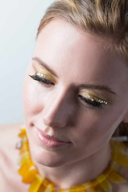 EYES  Get glowing with  Gilded Gold Caviar Stick Eye Colour ($29),  accented with loose glitter. Eyebrows are softly defined with  Ash Blonde Brow Pencil ($24).  Skin is perfected with Secret Camouflage Concealer ($35)   and  Candleglow Soft Luminous Foundation ($48)  all from Laura Mercier.
