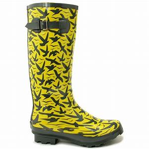 "A festive pair of ""Wellies"" handle the dirt or mud weather permitting for dancing and rambling."