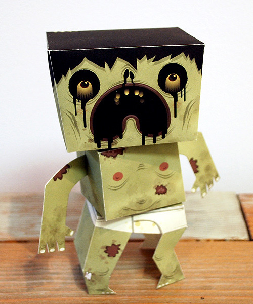 Exquisite Corpse opened last night at Light Grey Art Lab.  52 adorable paper-craft zombies for all the world to cower in fear at.