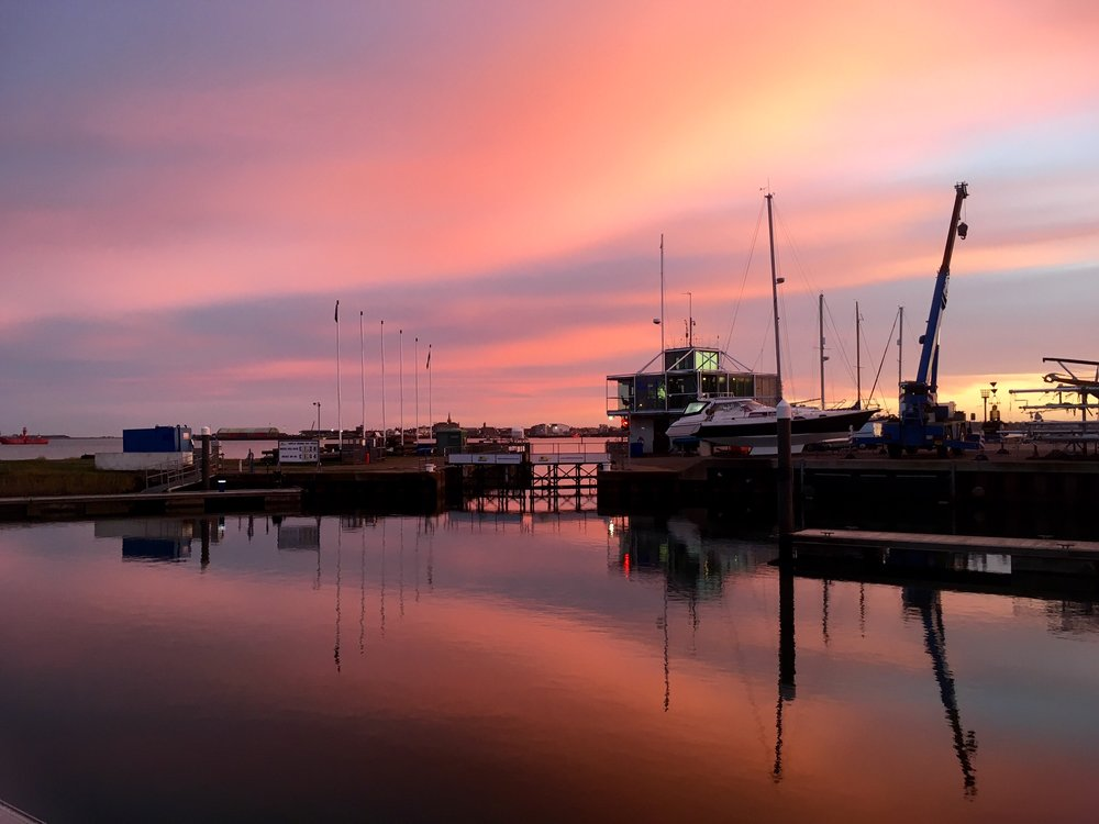 Sunset over the lock at Shotley Marina