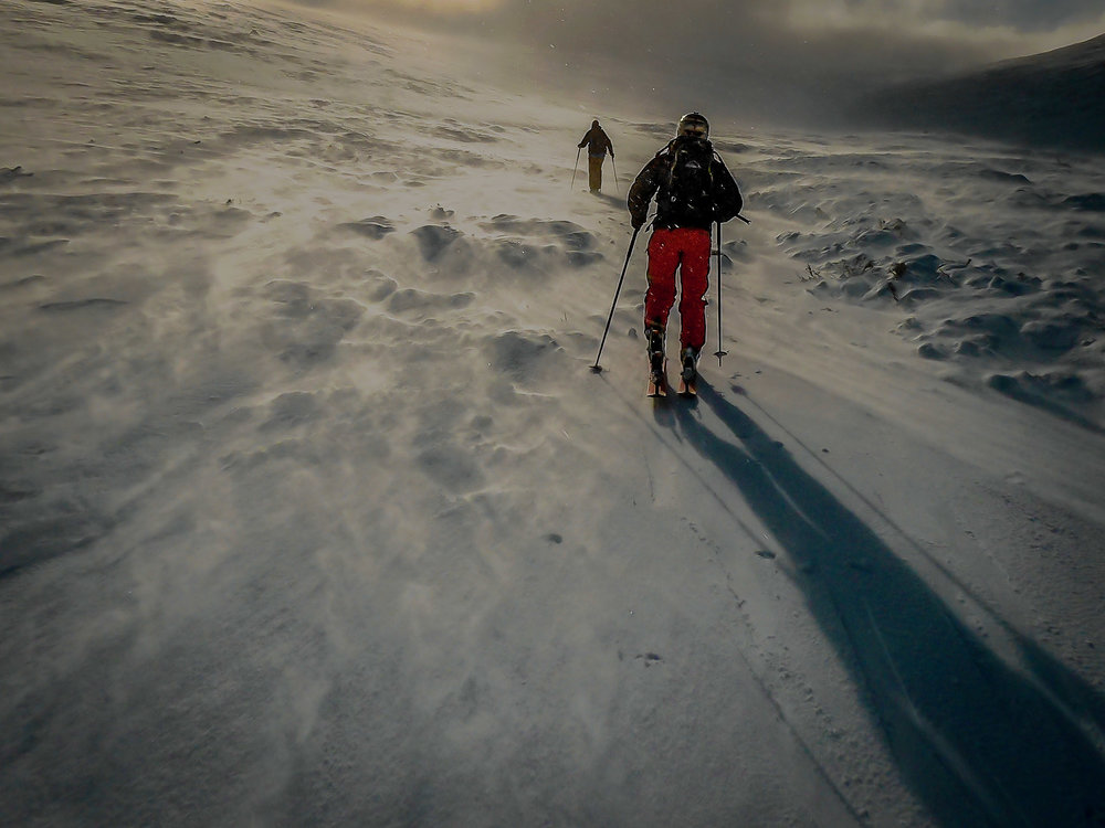 Skinning up Lurcher's Gully. The spindrift racing past makes the mountain feel like it has turned into a raging river.