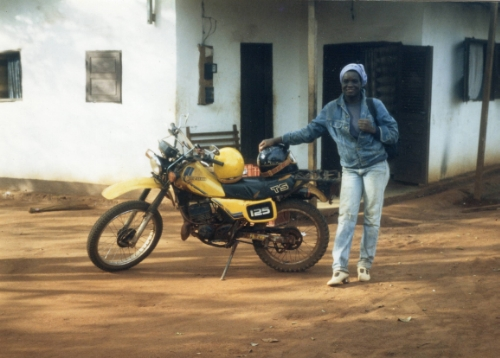 Eugenie, my wonderful Cameroonian co-worker, and the yellow Suzuki.