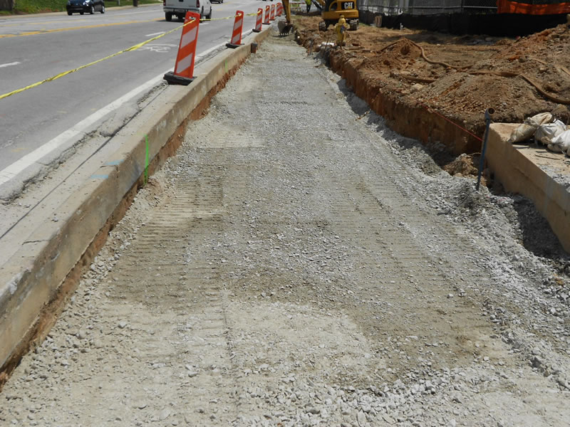Installation of stone base course for road widening near WHSCAB