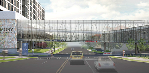 A two-story pedestrian bridge will rise over Clifton Road this month as Emory University Hospital continues progress on its new, state-of-the-art hospital tower. The bridge will be constructed in the center lanes and lifted into place.