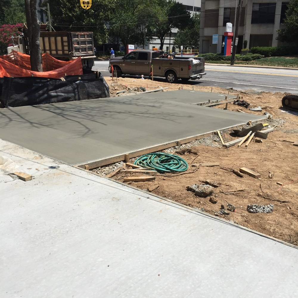 New Sidewalk and Pad for Bicycle Rack
