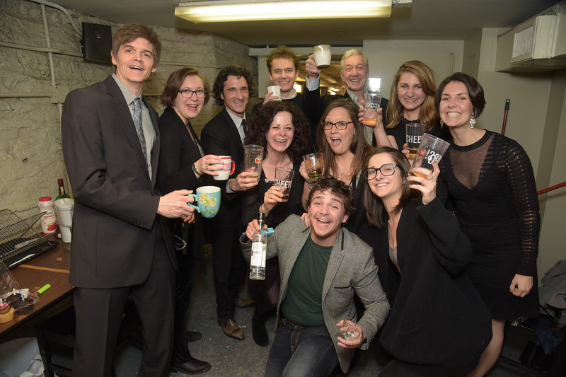 The whole crew raising a glass backstage to a successful opening