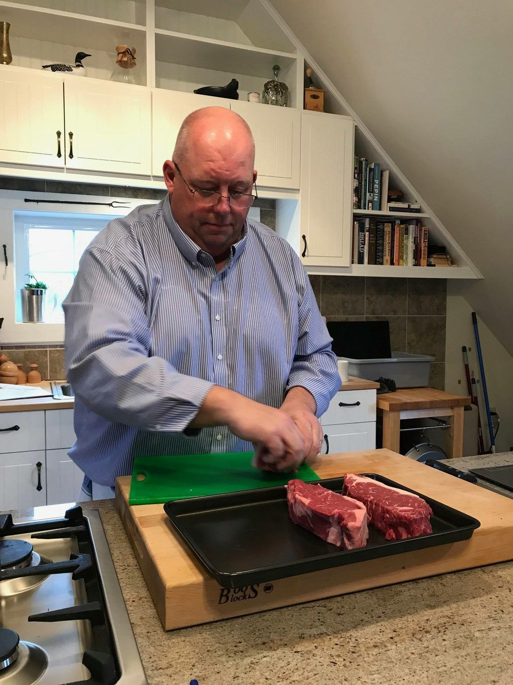 Chef Curtiss trimming steaks during a Steakhouse Classics class.  Photo courtesy of  Jim Hardman.