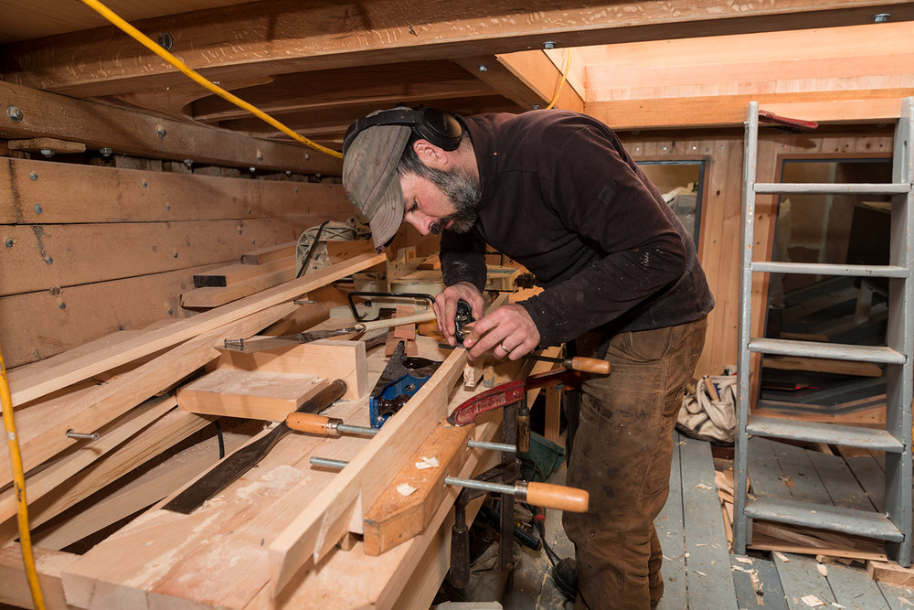 Ryan Graham down below working on the cabin sole.