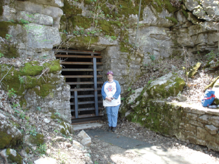 Kim Fedrick at the entrance to Manitou Cave. Photo by Larry E. Matthews, April 3, 2016.