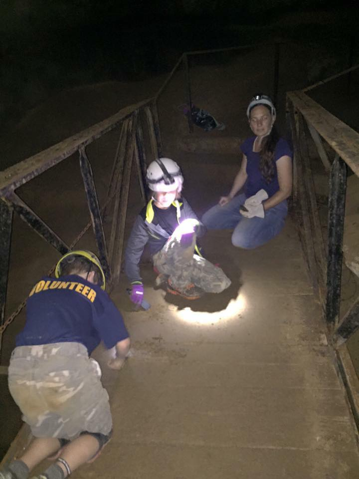 Volunteers scrub mud and debris from old bridge