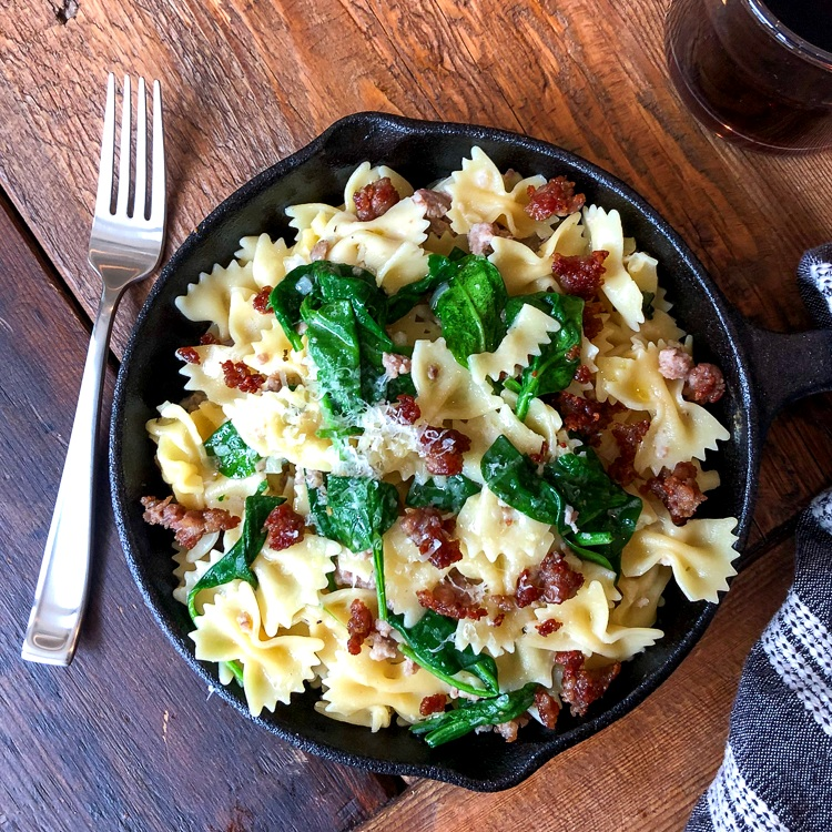 Farfalle with Pignole, Italian Sausage, Spinach and Parmesan Cream Sauce