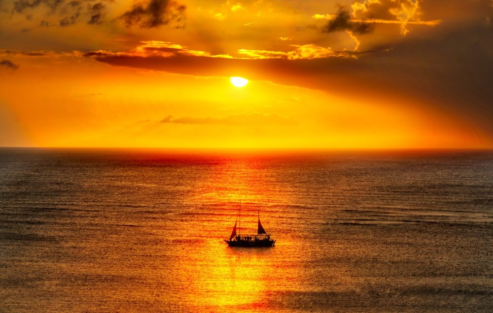Ship Sailing At Sunset In Aruba by Trey Ratcliff