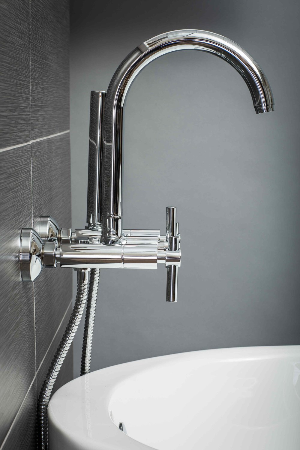 wall mount tub filler faucet and handshower in chrome with metal levers