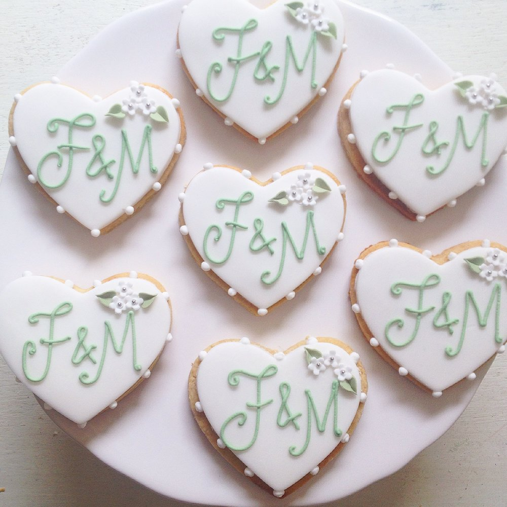 Monogrammed iced biscuit favours