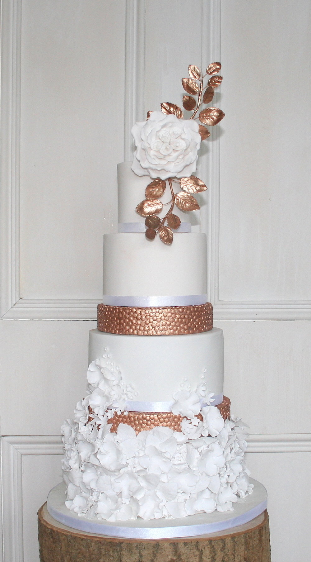 6 tier white & bronze wedding cake