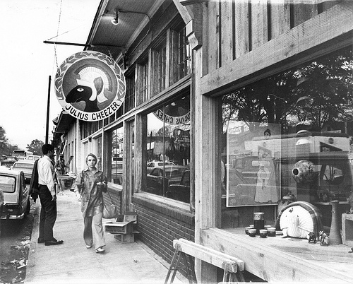 A view of the shops of Overton Square down Madison Avenue, including the wooden sign at Julius Cheever