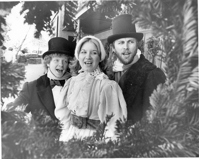 Dickensian characters dress up and carol for visitors during the Christmas season at Overton Square circa 1978