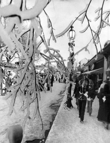 Snow machines provided a white Christmas for visitors to Overton Square as soon as the temperature fell below 28 degrees. Madison Avenue was blocked off for two weeks during the holidays for sleigh rides, ice skating, pony rides, puppet shows, chestnut sellers, and a pine tree forset along the street.   Photo by Robb Mitchell / The Commercial Appeal