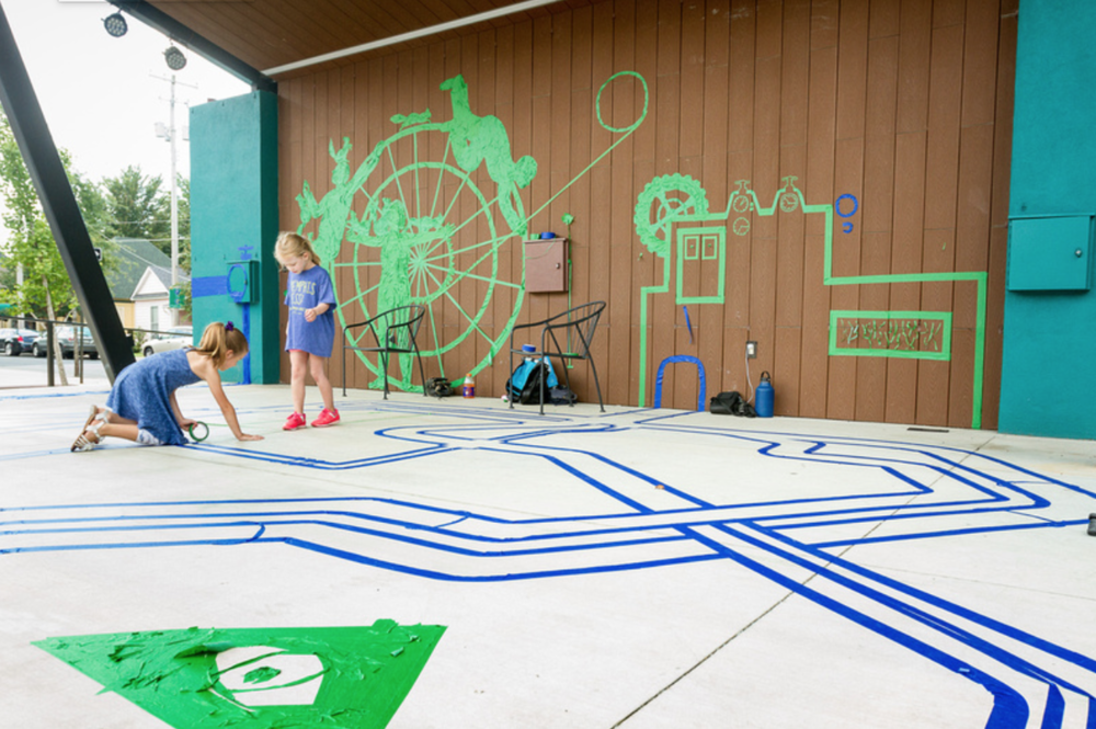 The international Tape Art Crew comes to Overton Square in conjunction with Brooks Museum, to the delight of young visitors
