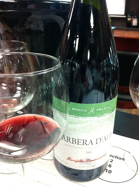 A lush glass of Barbera D'Alba, invokes your desire to drink for the people!