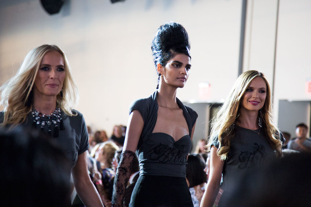 Keren Craig and Georgina Chapman  join their Made For History collection on the runway. Photo by Kristen Blush.