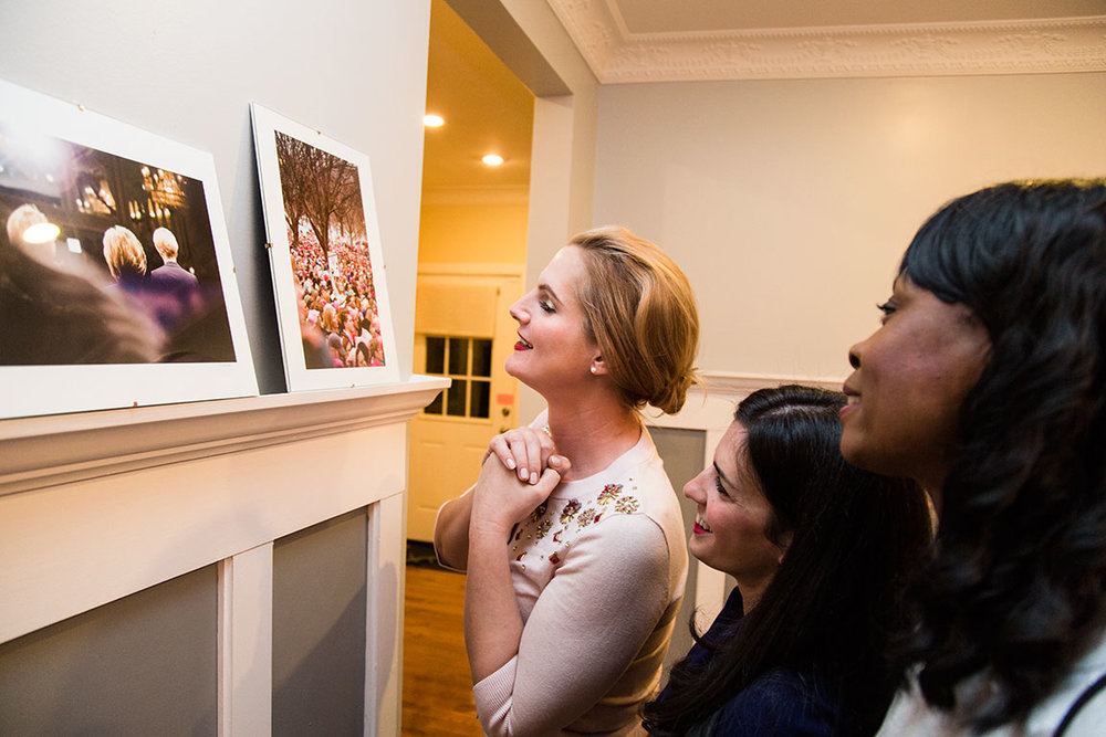 Members of the Hillary Clinton Brigade, Ella Frederick, Racheal Barasch, and Susan McMillan admire a photo of themselves participating in the Women's March on Washington, D.C.