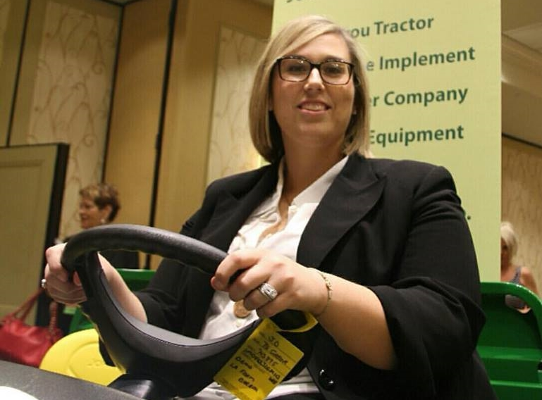 Katie Sistrunk is riding high on her new John Deere Gator after winning the Discussion Meet on Thursday. The Gator is part of Katie's prize package, which also includes a trip to Phoenix, AZ in January to compete for the national Discussion Meet title at the annual American Farm Bureau convention.