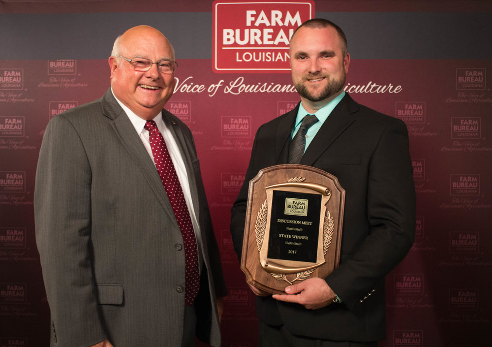 Adam Caughern (right) of Caddo Parish wins the 2017 Young Farmers and Ranchers Discussion Meet. The award was presented by Louisiana Farm Bureau President Ronnie Anderson.