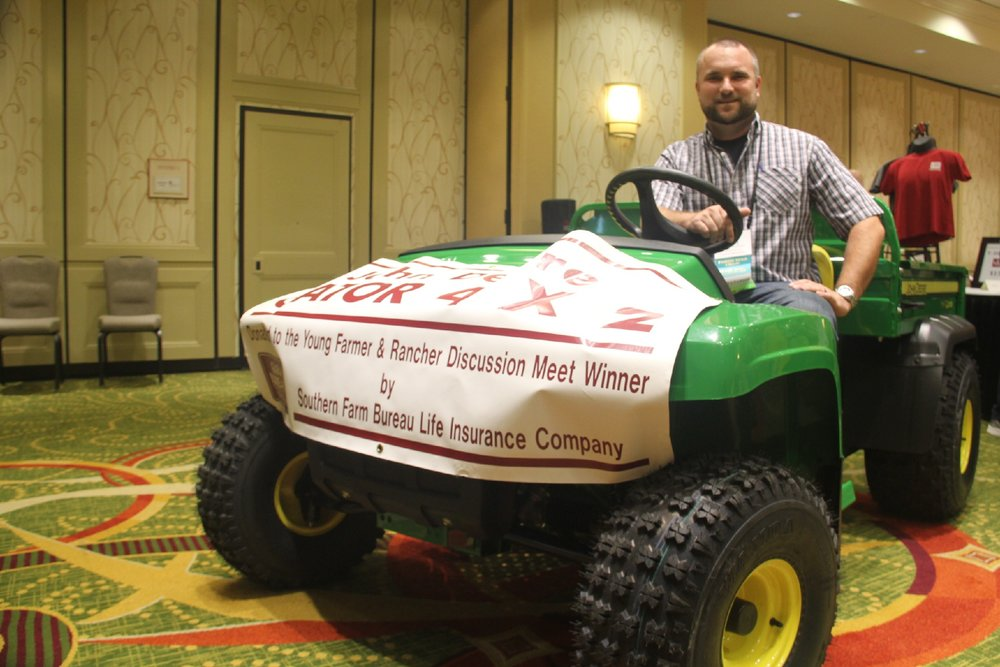 ADAM CAUGHERN WON A JOHN DEERE GATOR UTILITY VEHICLE IN THE LOUISIANA FARM BUREAU'S YOUNG FARMER AND RANCHER DISCUSSION MEET.