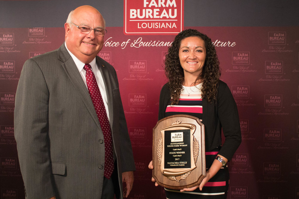 Louisiana Farm Bureau President Ronnie Anderson presented Acadiana farmer Natachia Stelly with the Louisiana Outstanding Young Farm Woman award at the Farm Bureau Convention in New Orleans.