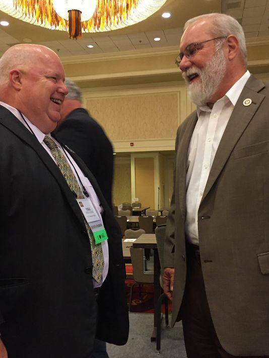 Republican Louisiana Agriculture Commissioner Mike Strain and state Sen. Bret Allain, R-Franklin, spoke to each other before speaking to the crowd this week at the Louisiana Farm Bureau Convention in New Orleans.(Photo: Greg Hilburn/USA Today Network)