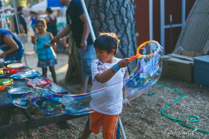Ian creates giant bubbles at the fair