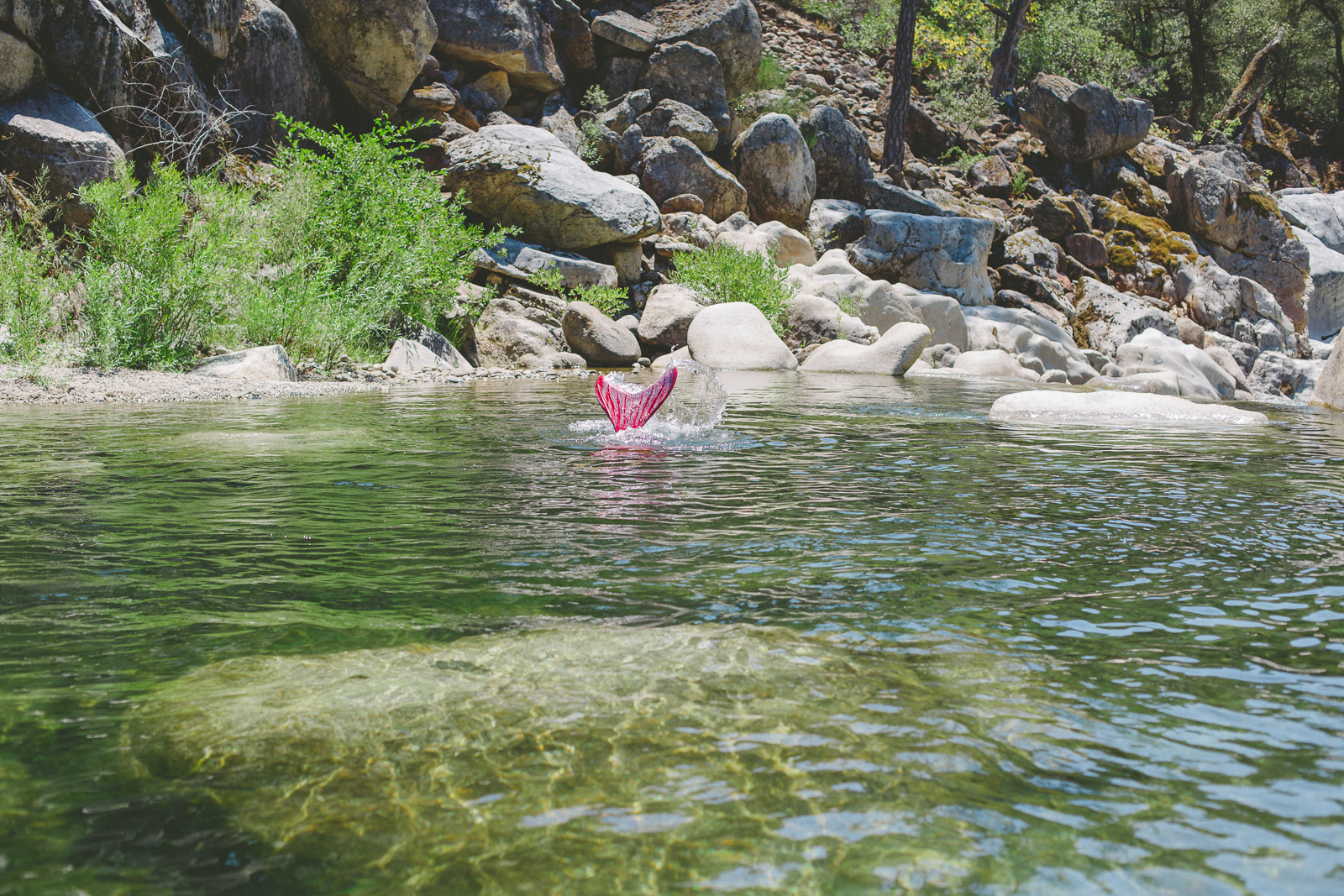 Mermaid flipping her tail in the Yuba River