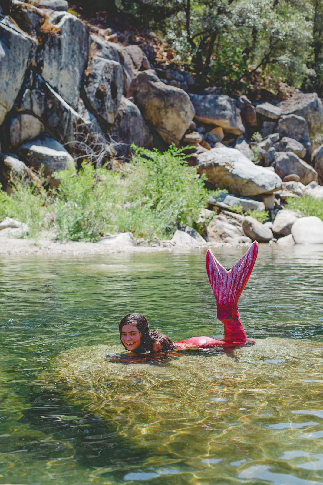 Mermaid in the Yuba River, Nevada City, showing off her Fin Fun Mermaid Tail
