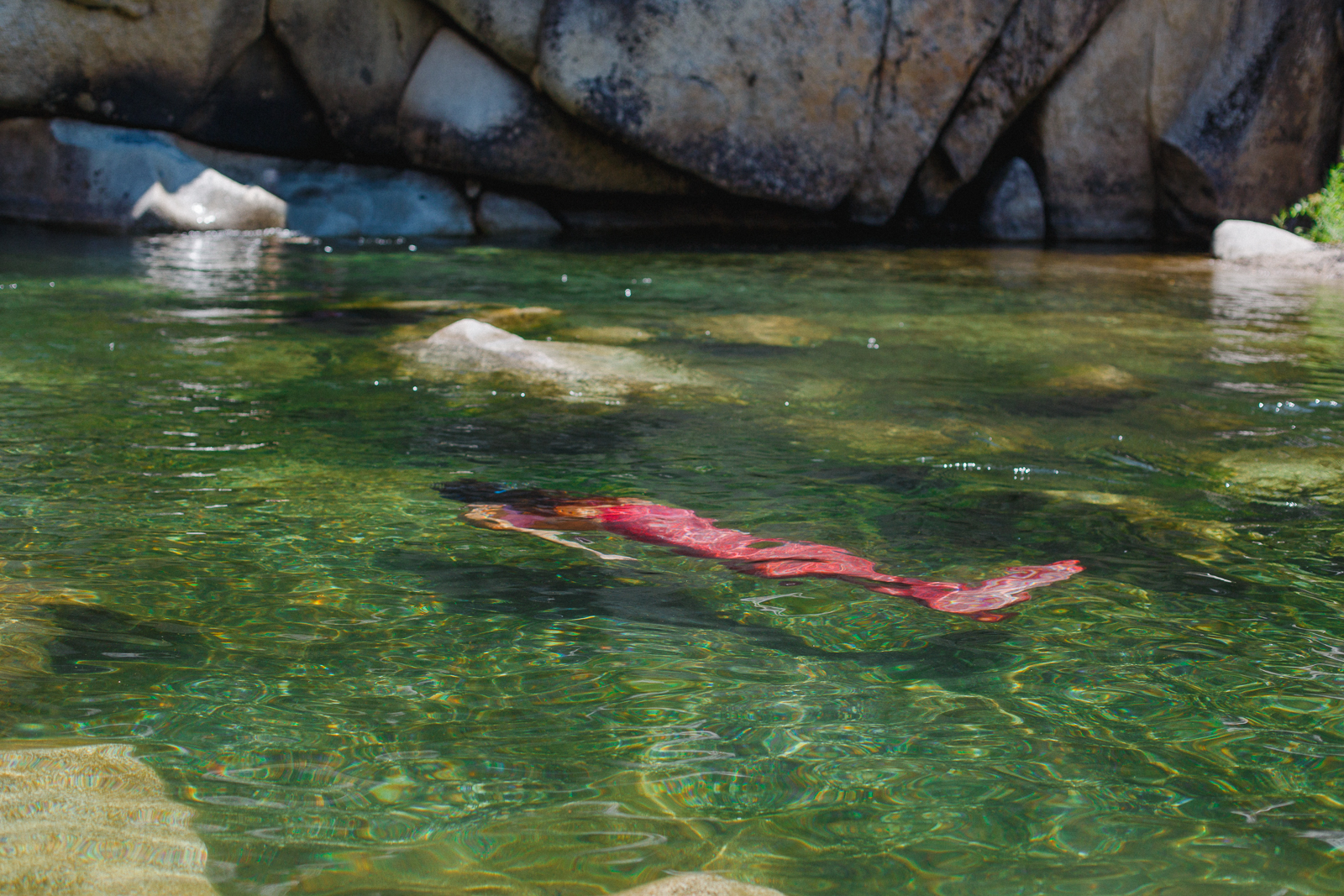 Mermaid underwater in the Yuba River outside Nevada City, California