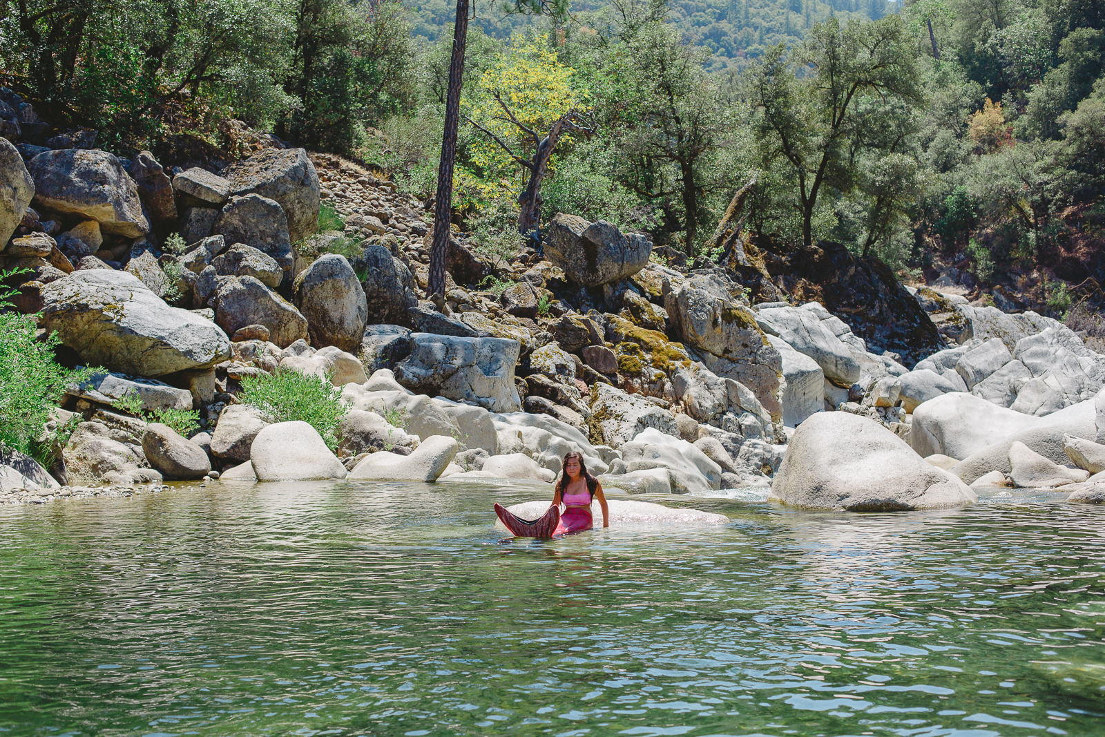 Mermaid posing at the rocky Yuba River