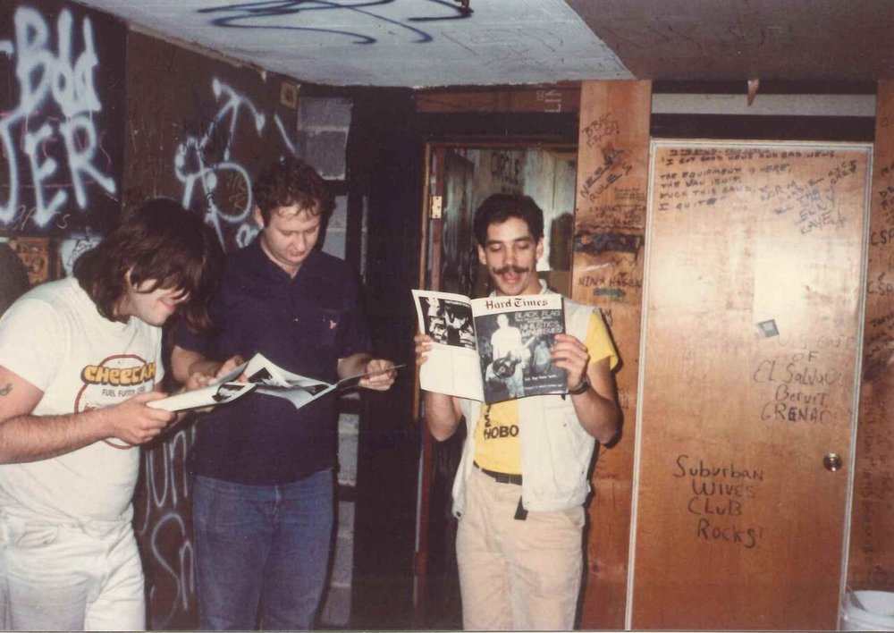 The Husker Du lads enjoying a fine issue of Hard Times backstage at City Gardens. Photo by Ron Gregorio