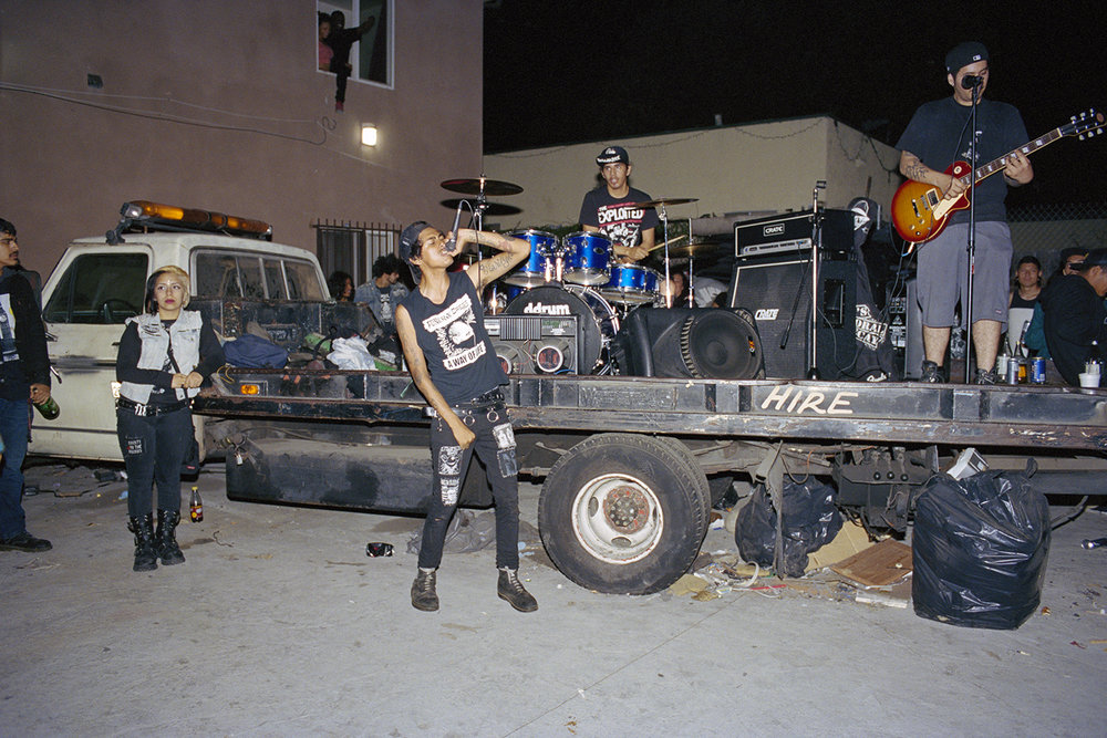Crusty Drunks play in a driveway South Central, L.A. August 1, 2014   photo by    Angela Boatwright