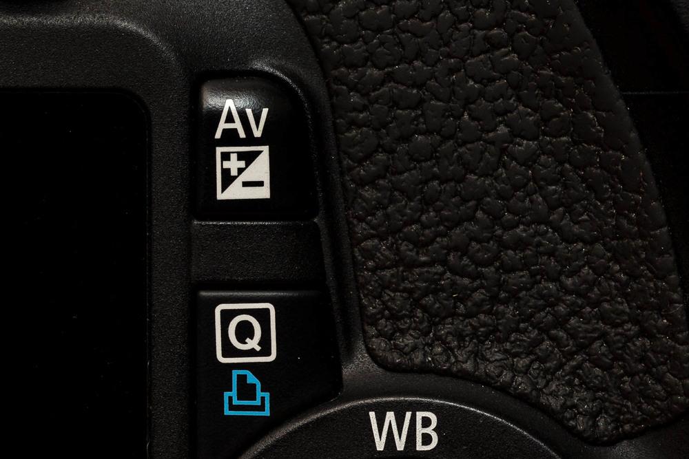 Canon 550D bouton Av +/-